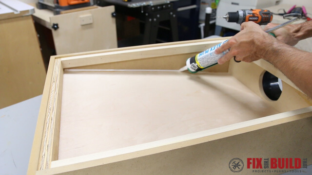 caulking the seams of dust chute downdraft table