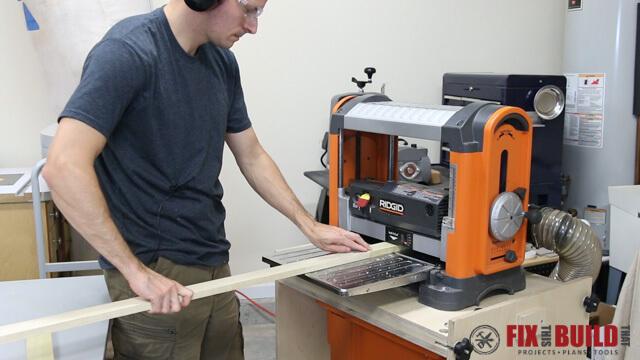 running a board through a ridgid planer