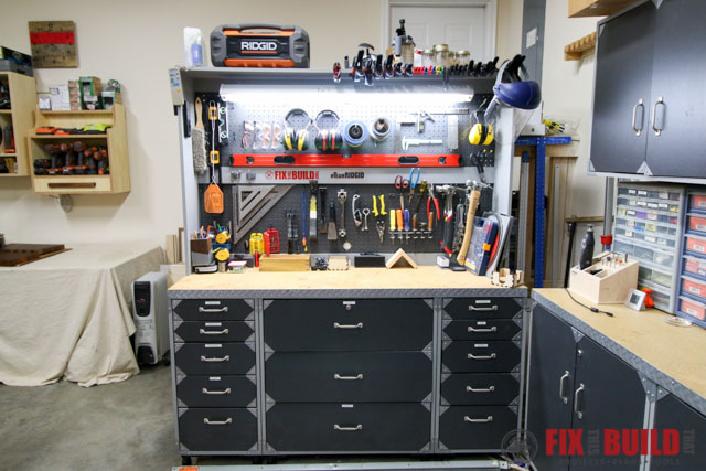 woodshop pegboard storage and cabinets