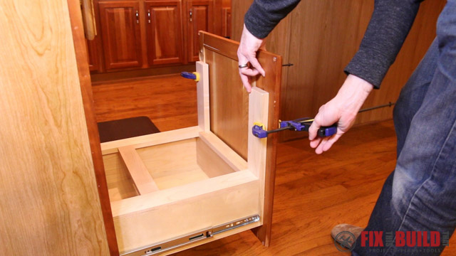 to install the cabinet door to the pull out drawer i clamped the door in place to see where the rails overlapped the vertical supports