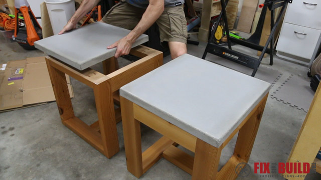 installing the top on a concrete side table