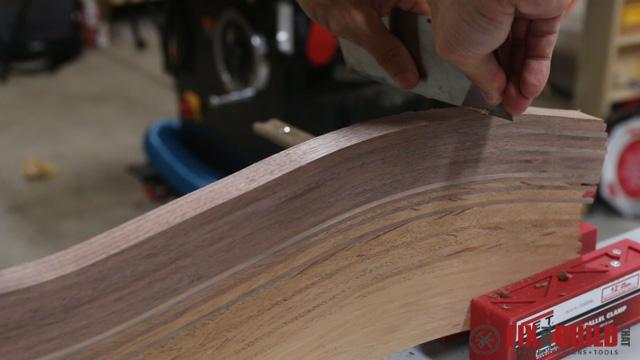 card scraper flattening a cutting board