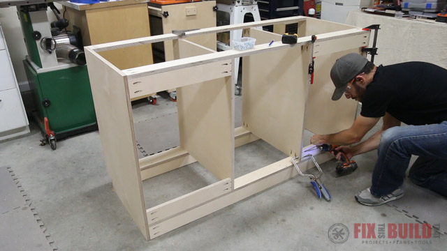 attaching mounting cleats to base cabinet