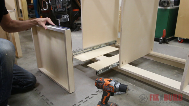 'installing pull out trays on a base cabinet' from the web at 'http://fixthisbuildthat.com/wp-content/uploads/2017/09/How-to-Build-a-Base-Cabinet-26.jpg'