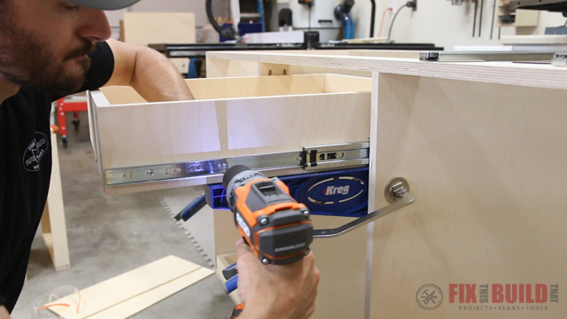 'using the Kreg drawer slide jig' from the web at 'http://fixthisbuildthat.com/wp-content/uploads/2017/09/How-to-Build-a-Base-Cabinet-28.jpg'