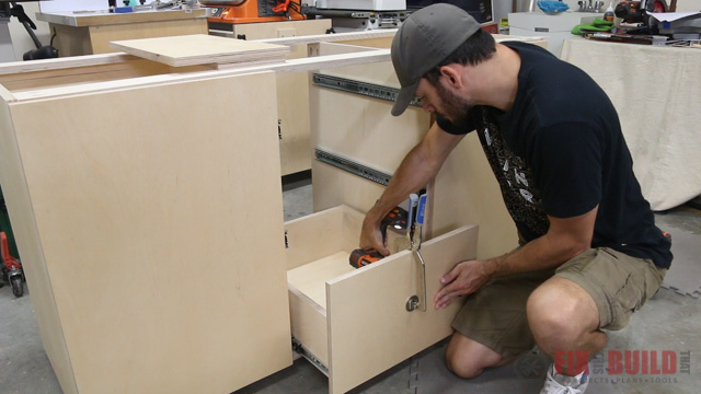 attaching false drawer fronts to the base cabinet drawers