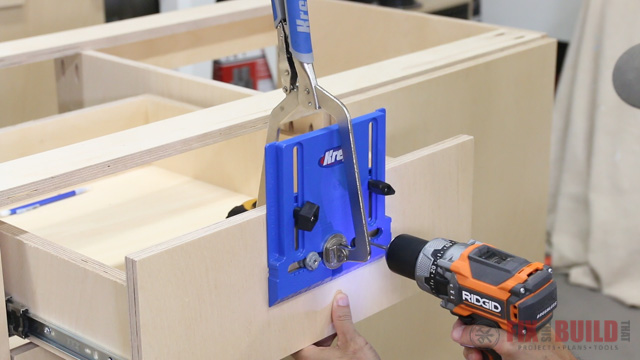 'using a kreg cabinet door hardware jig' from the web at 'http://fixthisbuildthat.com/wp-content/uploads/2017/09/How-to-Build-a-Base-Cabinet-40.jpg'