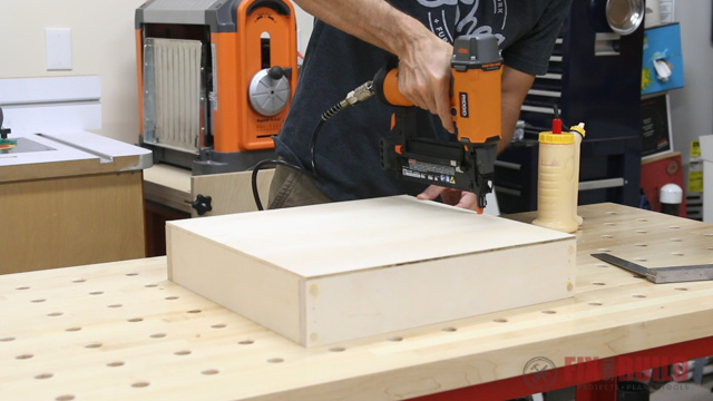 nailing on the bottom of a drawer with a brad nailer