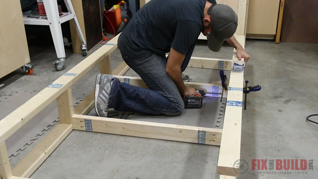 laying out twin bed frame with storage