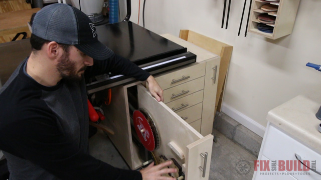 table saw cabinet for storage of saw blades