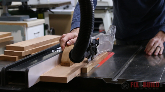 ripping down boards on a tablesaw