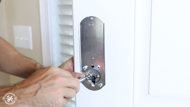 attaching inside of keyless deadbolt to front door