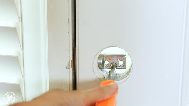 using screwdriver to close deadbolt