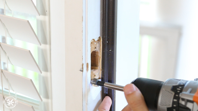 using drill to widen opening on door