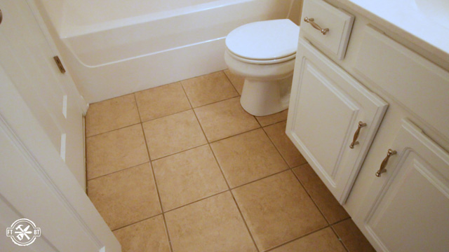 old tile floor in small bathroom