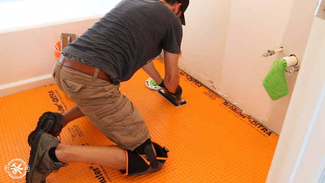 using grout float to attach ditra to mortar