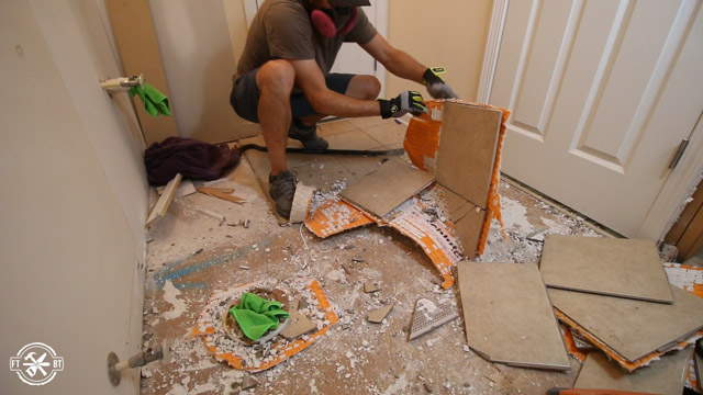 ripping up old tile floor in bathroom