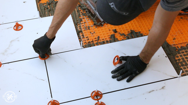 using the ridgid level max system to separate the tiles