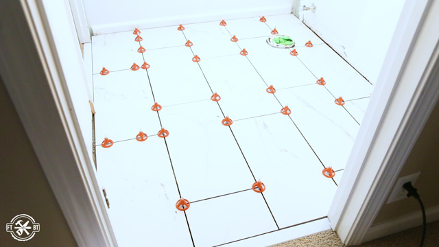 tile floor with spacers throughout