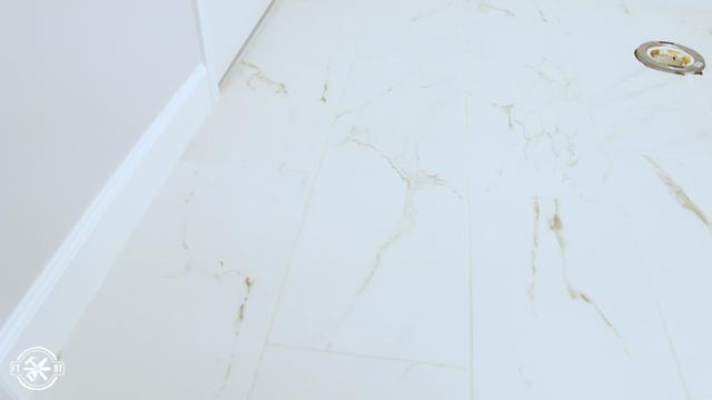 bathroom floor with large tiles