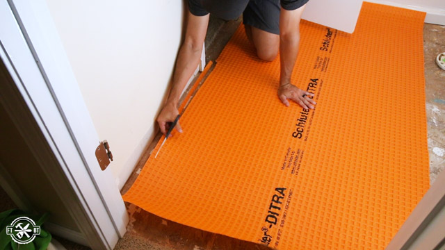 fitting the ditra underlayment in the bathroom