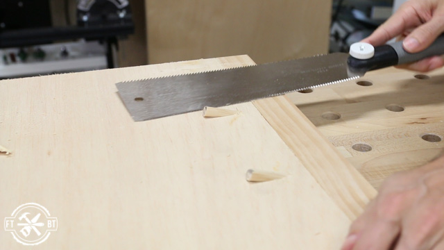 sawing off the top of wood plugs using pull saw