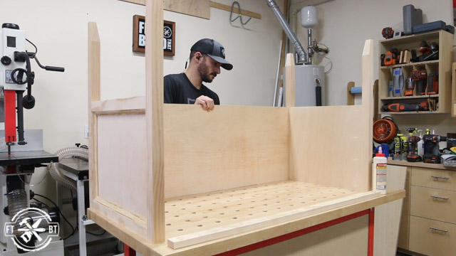 fitting the back stretcher on the wood desk