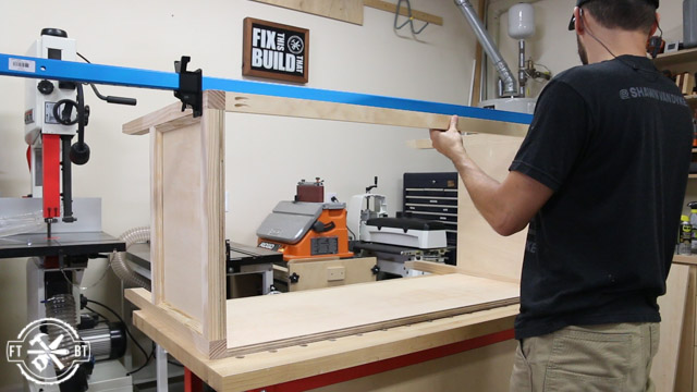 screwing the front stretcher on the wood desk