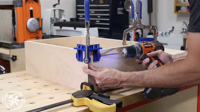 using corner clamp to screw wood drawers together