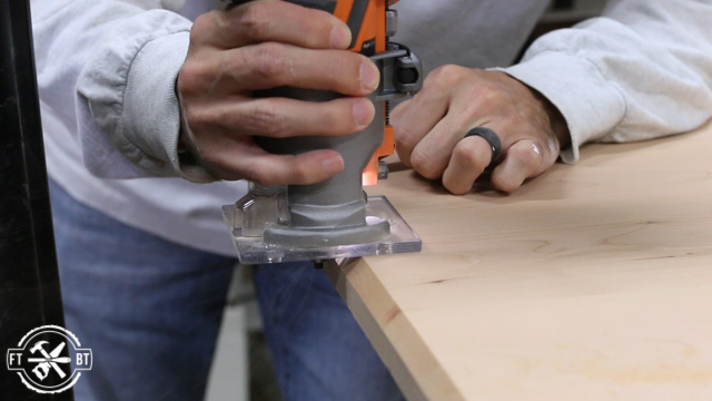 using cordless router to put chamfer on piece of wood