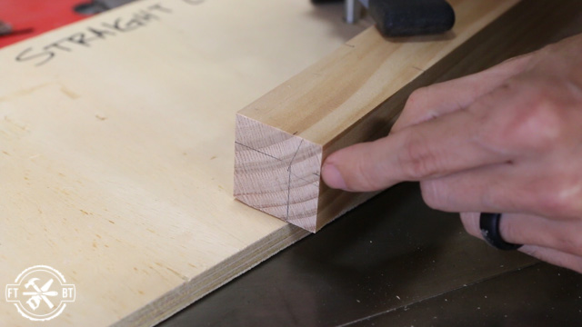 marking wood table leg with pencil to cut