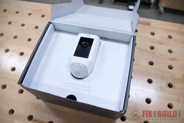 ring floodlight cam in box on wooden table