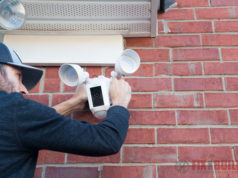 installing a ring floodlight cam on red brick wall