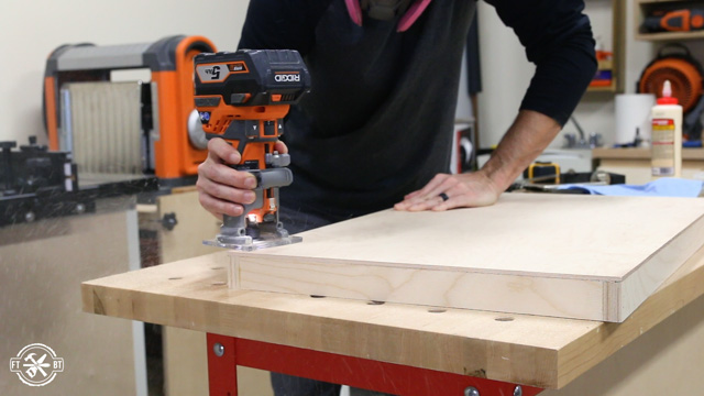 using router with chamfer bit to take off bottom edge of wood drawer
