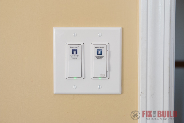 smart light switches on yellow wall