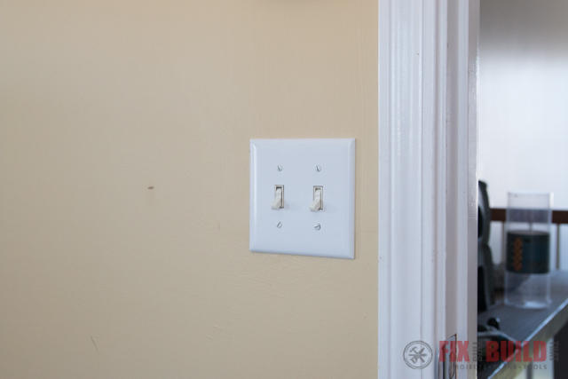 light switches on a yellow wall