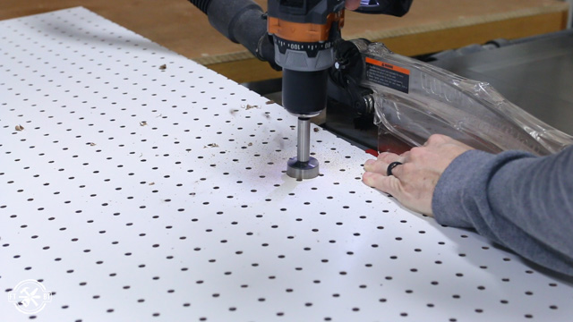 drilling holes in pegboard