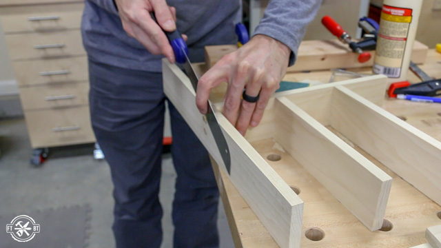 using pull saw to trim wood