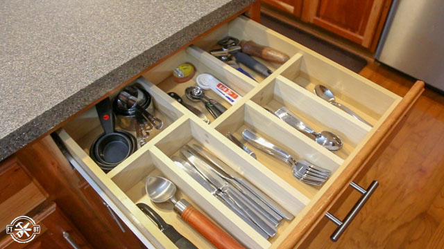 diy drawer organizer in wooden drawer with utensils