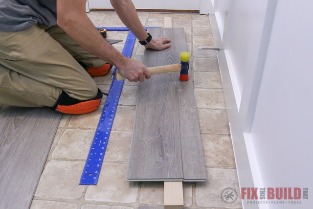snapping vinyl plank with mallet