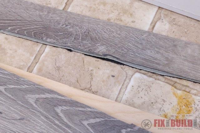 cutting vinyl plank flooring badly