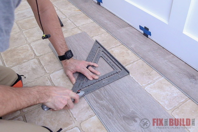 scoring vinyl plank flooring with a utility knife