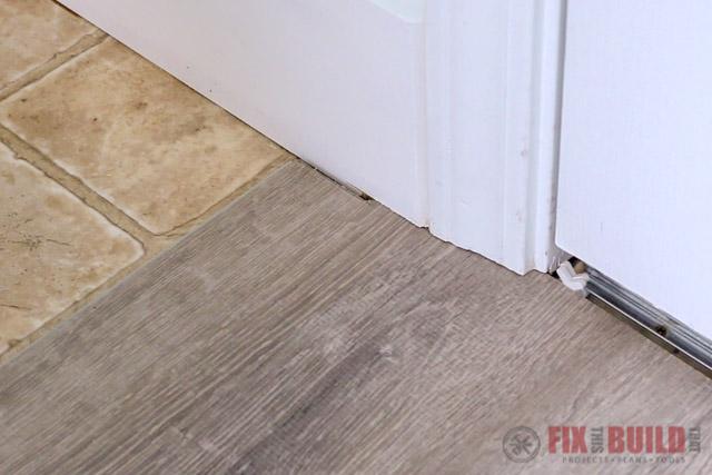installing vinyl plank flooring under door jamb