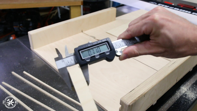 adjusting table saw sled with calipers