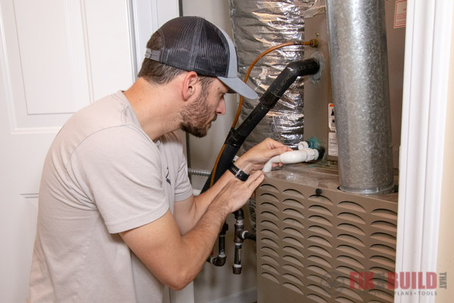 Checking condensate line on air conditioner
