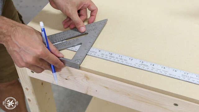 measuring and marking spots to attach work surface to top of table