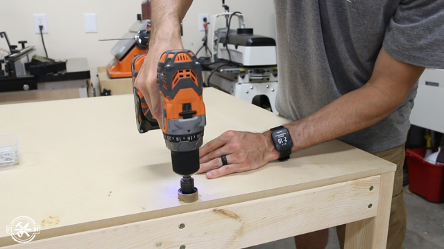 predrilling the holes with a countersink bit with a non-marring depth stop
