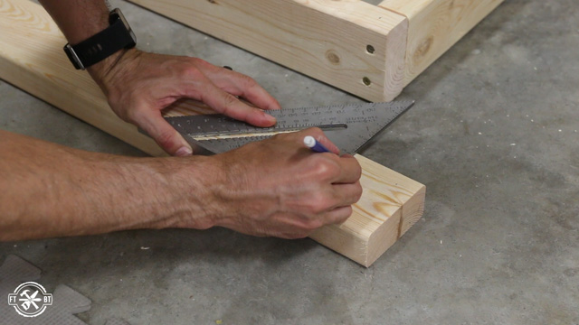 marking table legs to attach them with screws