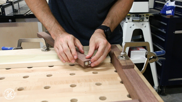 using metal dowel points to show where to drill holes