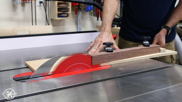 making cuts on table saw using tapering jig